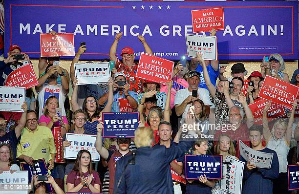 Republican presidential nominee Donald Trump waves to supporters during a campaign event at the Berglund Center on September 24, 2016 in Roanoke,...