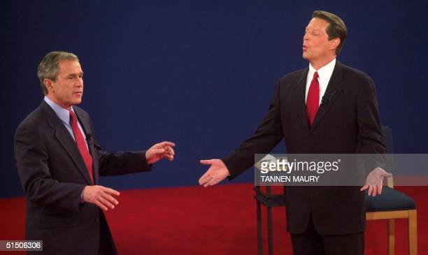 Republican presidential nominee George W Bush and Democratic presidential nominee Al Gore talk during their third debate at Washington University in...
