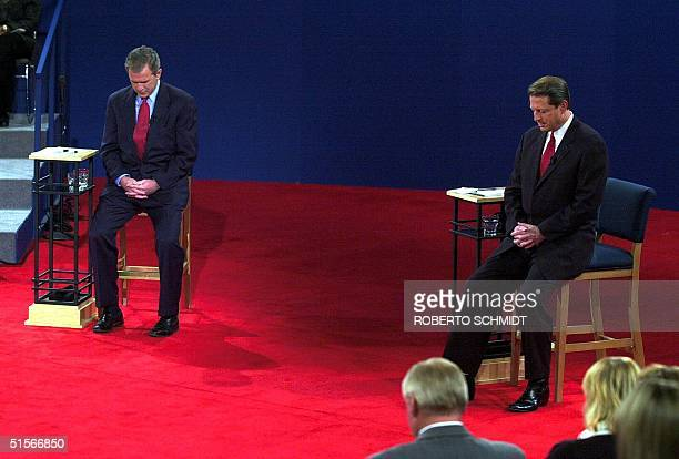 Republican presidential nominee George W Bush and Democratic presidential nominee Al Gore sit during a moment of silence before their debate at...