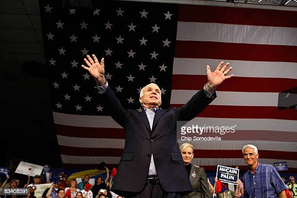 Republican presidential nominee John McCain his wife Cindy McCain and Florida Gov Charlie Crist hold a campaign rally at the Robarts Arena October 23...