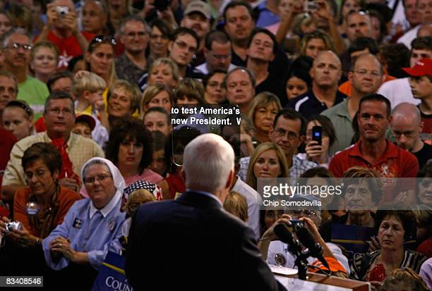 Republican presidential nominee John McCain speaks at a campaign rally aided by a teleprompter at the Robarts Arena October 23 2008 in Sarasota...