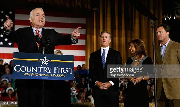 Republican presidential nominee Sen John McCain addresses a campaign rally with Denver Broncos former quarterback John Elway his wife Paige Green and...