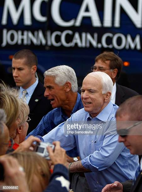 Republican presidential nominee Sen John McCain and Florida governor Charlie Crist greet supporters during a campaign rally at All Star Building...