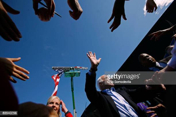 Republican presidential nominee Sen John McCain and his wife Cindy McCain greet supporters after addressing a campaign rally at the Raymond James...