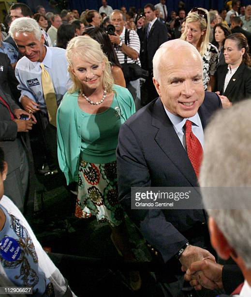 Republican presidential nominee Sen John McCain greets supporters with his wife Cindy left and Florida Gov Charlie Crist at the Asociacion Borinquena...