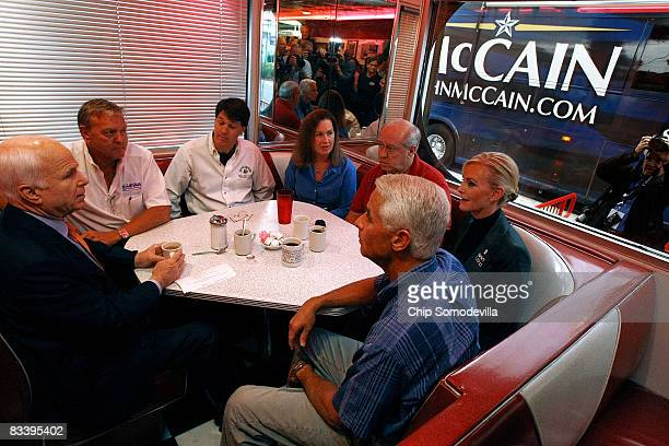 Republican presidential nominee Sen John McCain has coffee with small business owners Tom Crowe Tim Curtis Patricia Surguine Richard Rivers his wife...