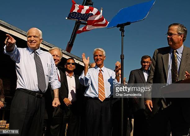 Republican presidential nominee Sen John McCain holds a campaign rally with Sen Joe Lieberman Florida Governor Charlie Crist Sen Mel Martinez and...