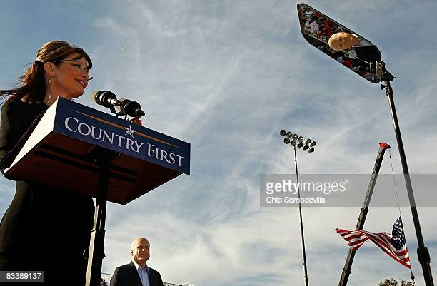 Republican presidential nominee Sen John McCain is reflected in a teleprompter screen as his running mate Alaska Governor Sarah Palin addresses a...