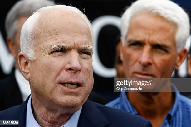 Republican presidential nominee Sen John McCain makes a statement to the news media with Florida Governor Charlie Crist after having lunch with...