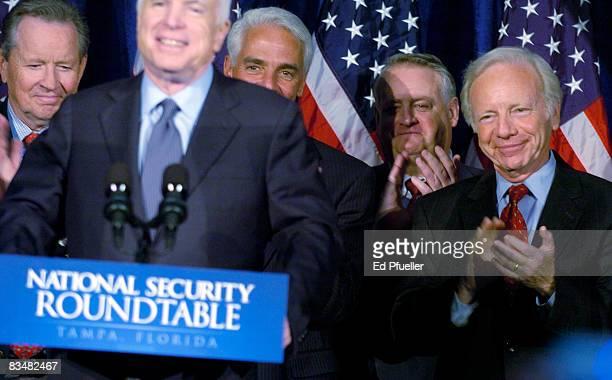 Republican presidential nominee Sen John McCain speaks on national security as advisors including Gov Charlie Crist of Florida and Sen Joe Lieberman...