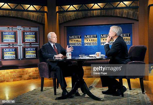 Republican presidential nominee Sen John McCain speaks with Tom Brokaw on the set of Meet The Press October 26 2008 in Waterloo Iowa The two...