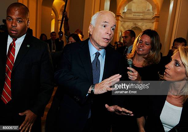 Republican presidential nominee Sen. John McCain talks to reporters as he arrives at his Capitol Hill office in the Russell Senate Office, September...
