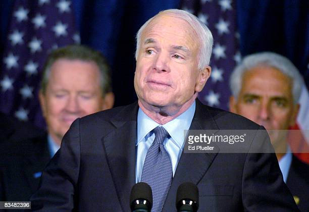 Republican presidential nominee Sen John McCain with advisors including Florida Gov Charlie Crist gives a speech to a crowd of supporters after a...