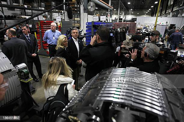 Republican presidential presidential candidate former Utah Gov Jon Huntsman tours the production plant of Goss International with his wife Mary Kaye...