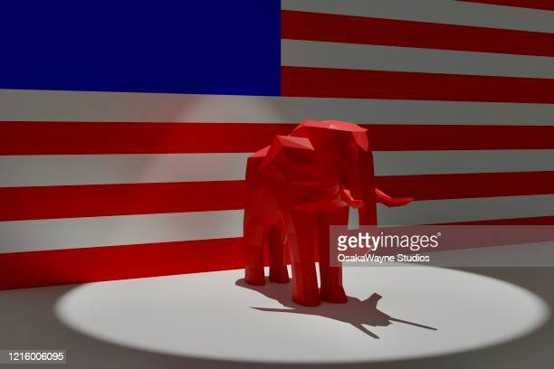 republican red elephant in spotlight on top of american flag - アメリカ共和党 ストックフォトと画像