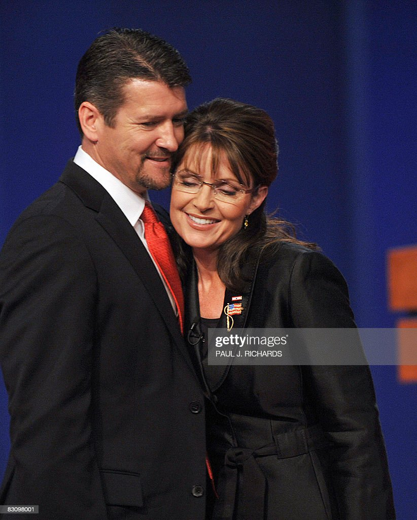 Republican Sarah Palin is embraced by husband Todd Palin following her vice presidential debate with Democrat Joseph Biden October 2, 2008 at Washington University in St. Louis, Missouri. Vice presidential nominees Palin and Biden clashed at their crucial vice presidential debate, with the Alaska governor under pressure to quell questions about her knowledge and experience.