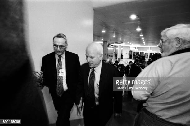 Republican Sen John McCain of Arizona arrives at the US Capitol building on his way to the second to last day of the Senate Impeachment Trial of...
