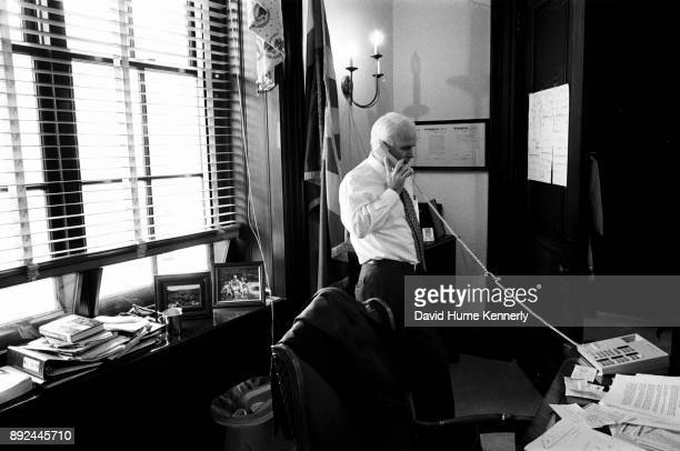 Republican Sen John McCain of Arizona on the phone in his office during a break from the Senate Impeachment Trial of President Bill Clinton on Jan 29...