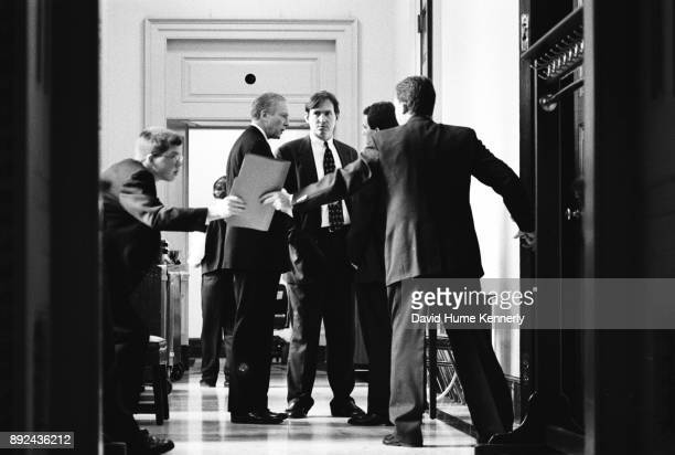 Republican Sen Orrin Hatch of Utah confers with aides during the Senate Impeachment Trial of President Bill Clinton on January 15 1999