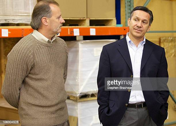 Republican Senate candidate Dino Rossi talks with Laurel Graphics Digital and Screen Printing President Keith Finnelly at the small business'...