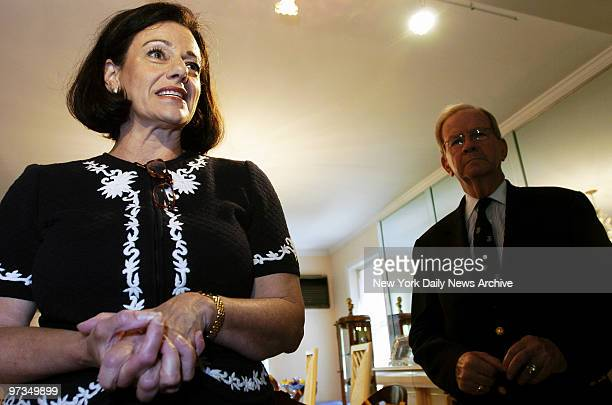 Republican Senate candidate Kathleen McFarland speaks to news media as former National Security Adviser Robert McFarlane stands by at the home of a...