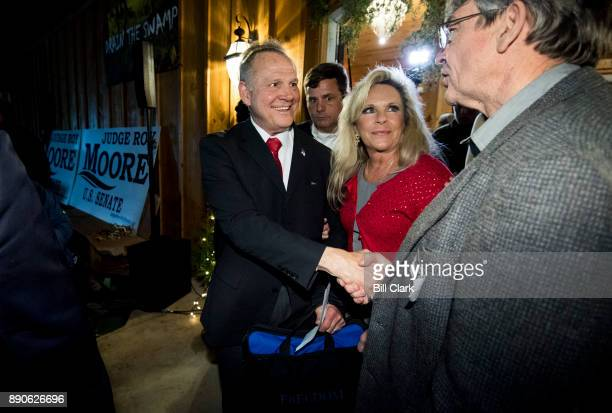 Republican Senate candidate Roy Moore left and his wife Kayla leave Moore's 'Drain the Swamp' rally in Midland City Ala on Monday Dec 11 2017