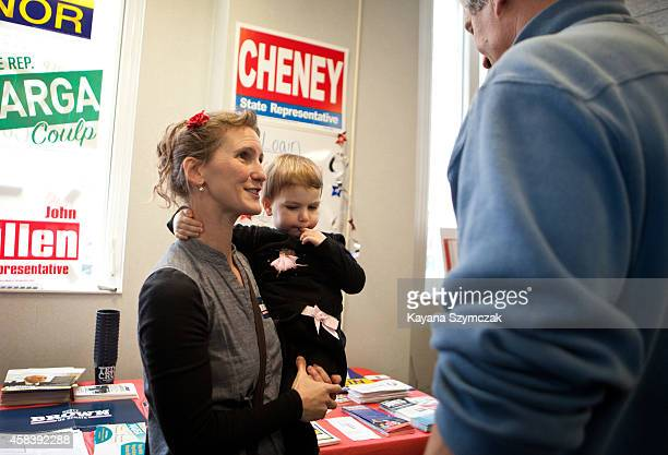 Republican Senate candidate Scott Brown greets supporters Mary Hopkins and Maybelle Hopkins at the New Hampshire GOP Victory office on November 4...