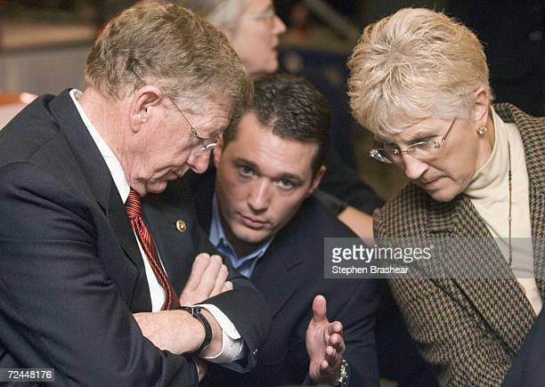 Republican Senator Conrad Burns speaks with senior adviser Erik Iverson and former Montana governor Judy Martz during Burns' victory party at the...