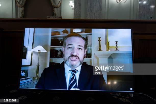 Republican Senator from Texas Ted Cruz appears on a monitor as he directs a line of questions toward CEO of Twitter Jack Dorsey during the Senate...