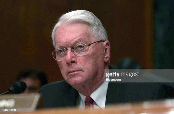 Republican Senator Jim Bunning of Kentucky asks a question at a Senate Banking Housing and Urban Affairs Committee hearing on stock options...