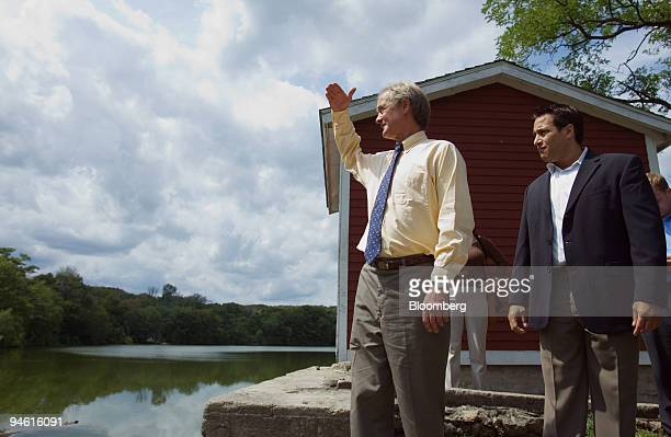 Republican Senator Lincoln Chafee of Rhode Island left surveys Barney's Dam as Lincoln Town Planner Albert V Ranaldi Jr looks on Thursday August 24...