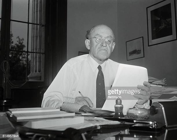 Republican Senator Ralph E. Flanders of Vermont, who on July 30th formally asked the Senate to censure Senator Joseph R. McCarthy, receives a pat on...