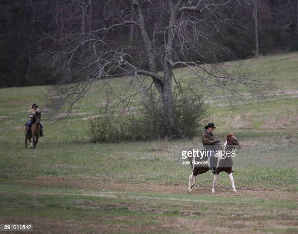 Republican Senatorial candidate Roy Moore and his wife Kayla Moore arrive on horseback to cast their vote at a polling location setup in the Fire...