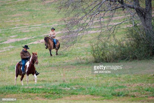 Republican Senatorial candidate Roy Moore and his wife Kayla ride their horses to the polling station to vote in Gallant Alabama on December 12 2017...