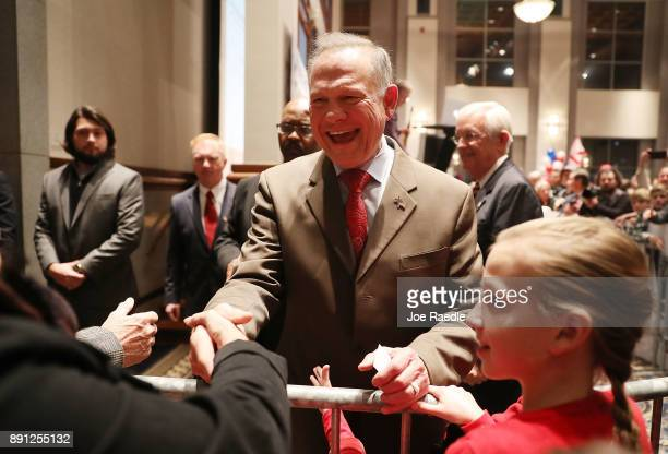 Republican Senatorial candidate Roy Moore arrives for his election night party in the RSA Activity Center on December 12 2017 in Montgomery Alabama...