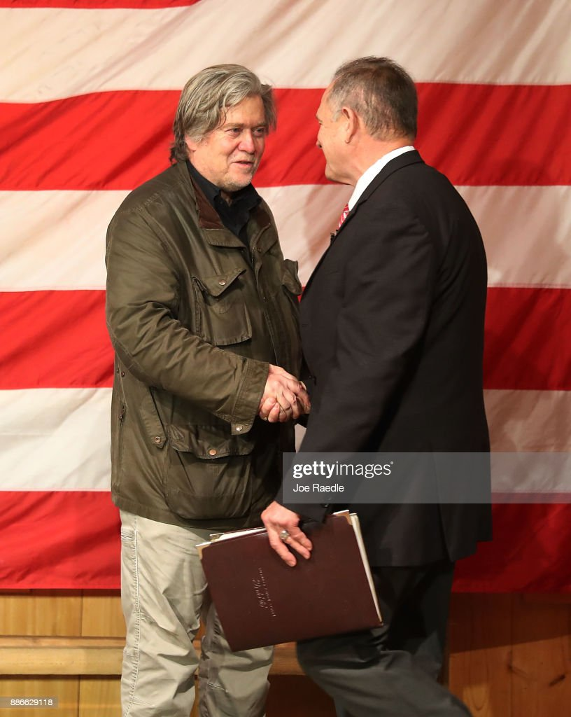 Republican Senatorial candidate Roy Moore is welcomed to the stage by Steve Bannon (L) as he introduces him during a campaign event at Oak Hollow Farm on December 5, 2017 in Fairhope, Alabama. Mr. Moore is facing off against Democrat Doug Jones in next week's special election for the U.S. Senate.