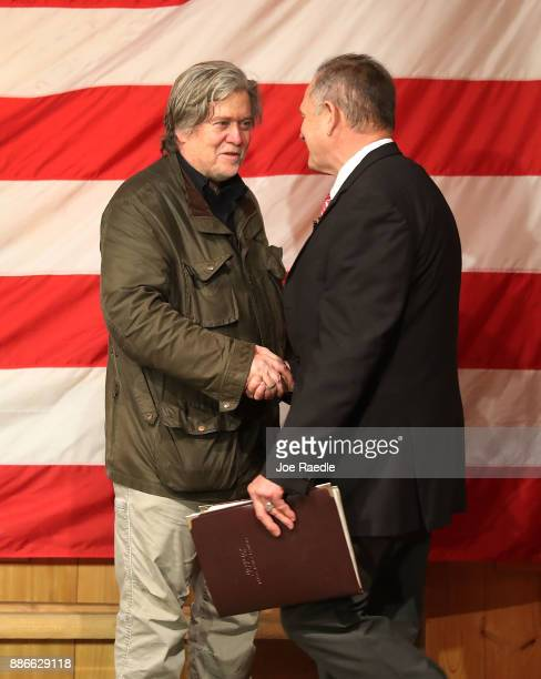 Republican Senatorial candidate Roy Moore is welcomed to the stage by Steve Bannon as he introduces him during a campaign event at Oak Hollow Farm on...