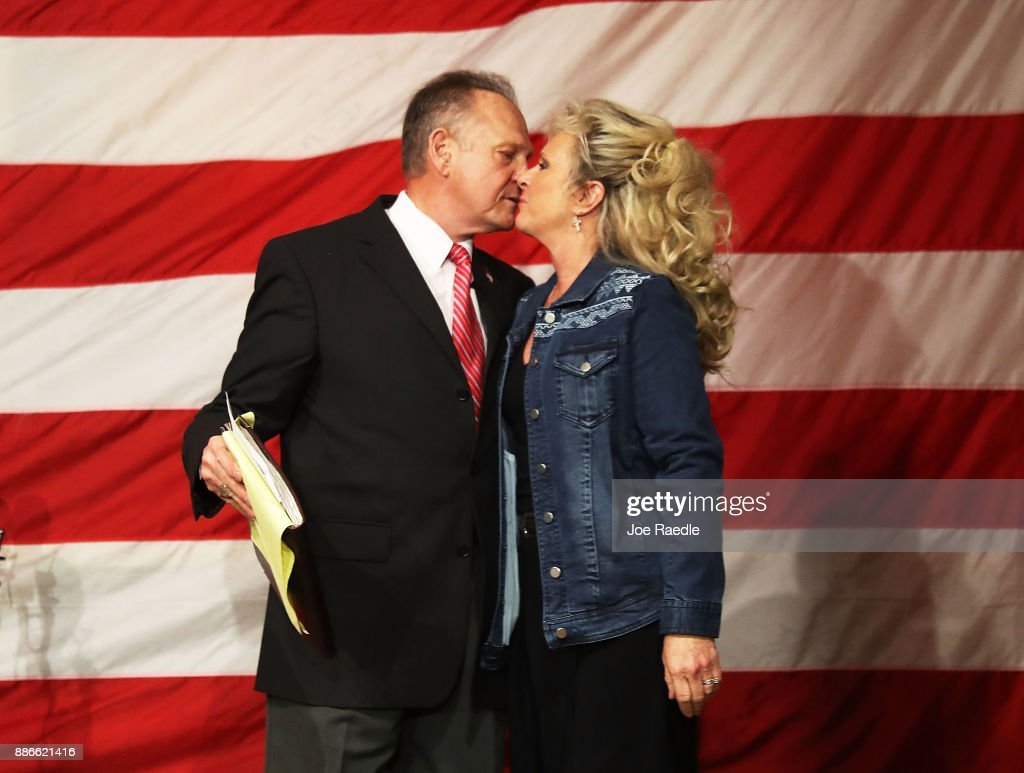 Republican Senatorial candidate Roy Moore kisses his wife Kayla Moore during a campaign event at Oak Hollow Farm on December 5, 2017 in Fairhope, Alabama. Mr. Moore is facing off against Democrat Doug Jones in next week's special election for the U.S. Senate.