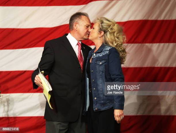 Republican Senatorial candidate Roy Moore kisses his wife Kayla Moore during a campaign event at Oak Hollow Farm on December 5 2017 in Fairhope...