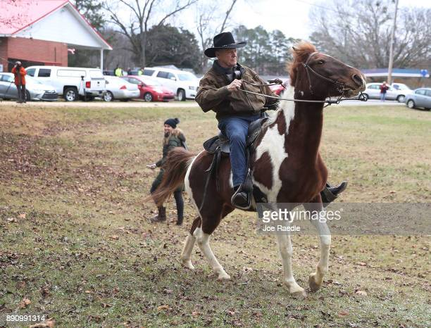 Republican Senatorial candidate Roy Moore rides his horse after casting his vote at the polling location setup in the Fire Department on December 12...