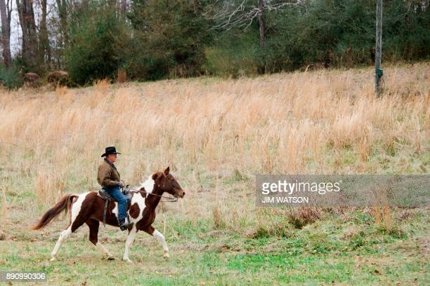 TOPSHOT Republican Senatorial candidate Roy Moore rides his horse Sassy to the polling station to vote in Gallant Alabama on December 12 2017 The...
