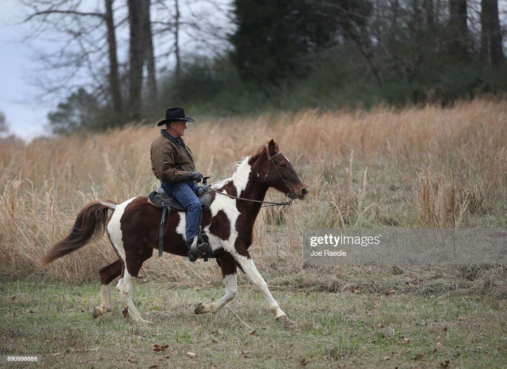 GOP Senate Candidate Judge Roy Moore Arrives At Polling Station To Vote By Horseback