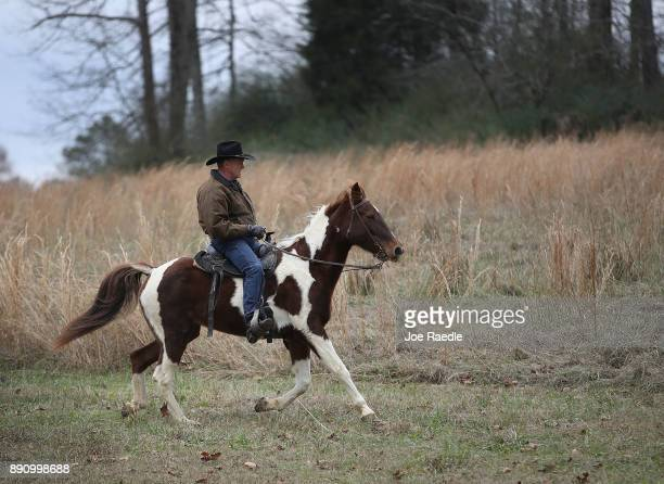 Republican Senatorial candidate Roy Moore rides his horse to cast his vote at the polling location setup in the Fire Department on December 12 2017...