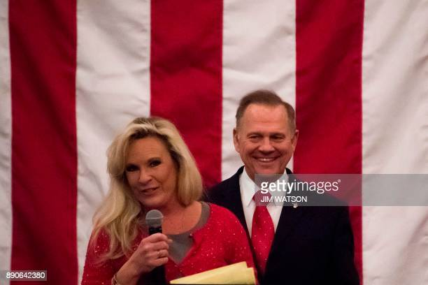 Republican Senatorial candidate Roy Moore smiles as his wife Kayla speaks at a rally in Midland Alabama on December 11 2017 / AFP PHOTO / JIM WATSON