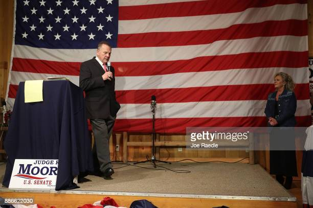 Republican Senatorial candidate Roy Moore speaks as his wife Kayla Moore looks on during a campaign event at Oak Hollow Farm on December 5 2017 in...