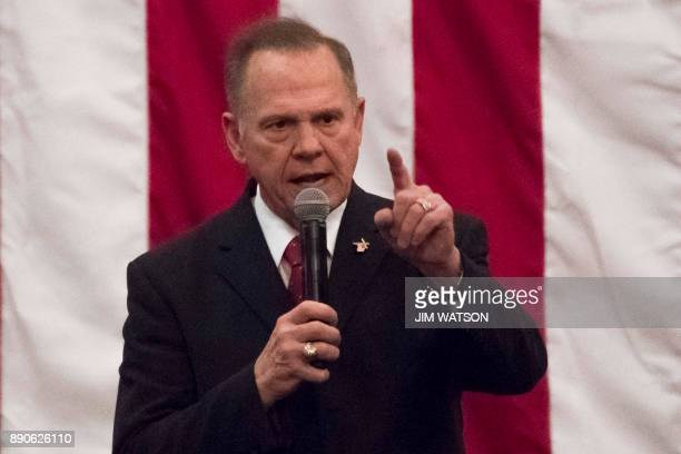 Republican Senatorial candidate Roy Moore speaks at a rally in Midland Alabama on December 11 2017 / AFP PHOTO / JIM WATSON