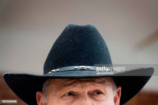 Republican Senatorial candidate Roy Moore speaks to the media after arriving at a polling station in Gallant Alabama on December 12 2017 The state of...