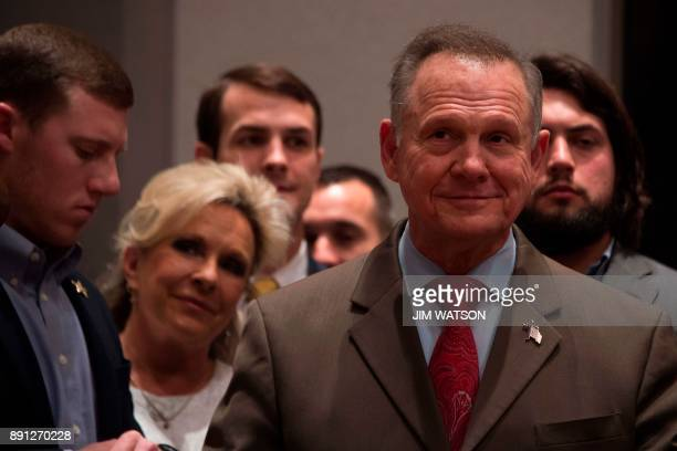 Republican Senatorial candidate Roy Moore stands off stage with his wife Kayla before addressing his supporters in Montgomery Alabama on December 12...
