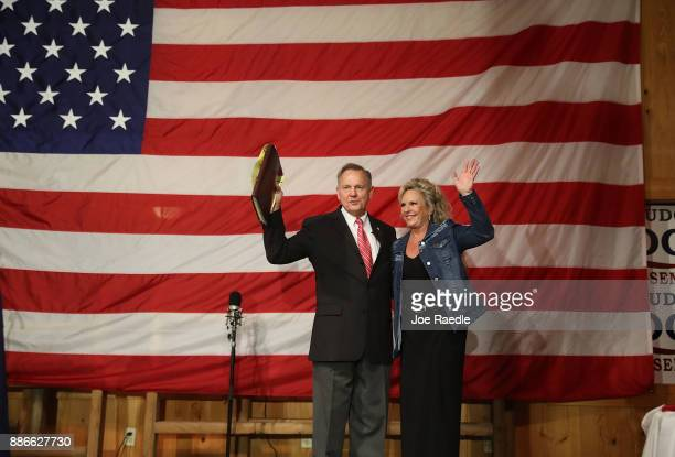 Republican Senatorial candidate Roy Moore stands with his wife Kayla Moore during a campaign event at Oak Hollow Farm on December 5 2017 in Fairhope...