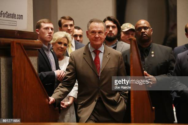Republican Senatorial candidate Roy Moore waits to be introduced to speak about the race against his Democratic opponent Doug Jones is too close and...